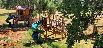 childrens-backyard-playground-slide-swings-rock-climbing