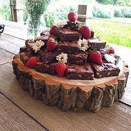 Chocolate Brownie Tower served on wood log
