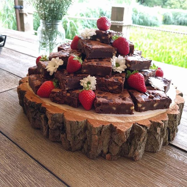 Triple chocolate brownies tower with strawberries, dessert for sharring