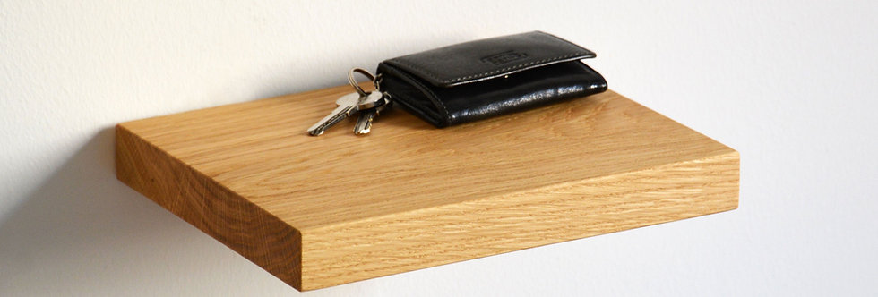 oak floating shelf with keys