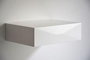 minimalist bedside drawer with white geometric design