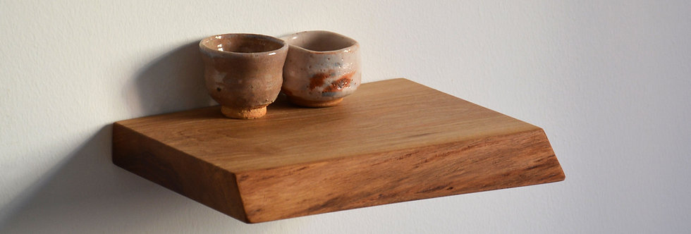 live edge floating shelf with tea cups