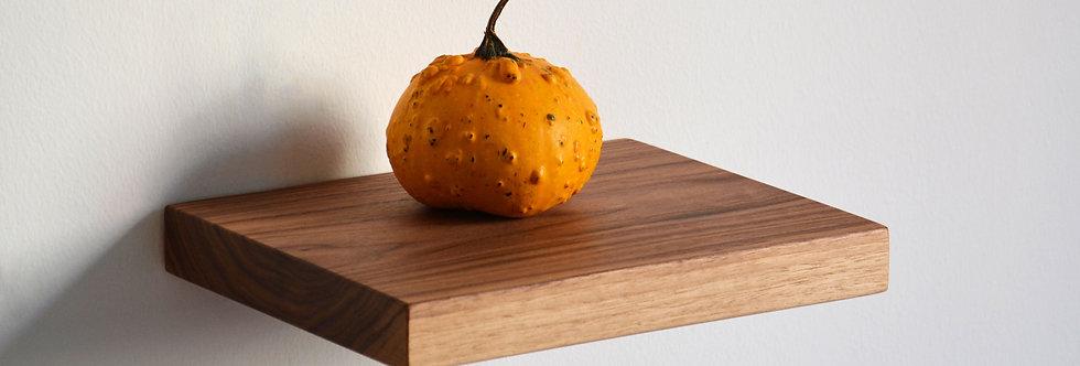 walnut floating shelf with pumpkin