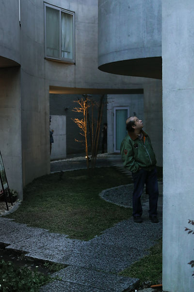 Okurayama Apartments by Dusk with interested Passer-by