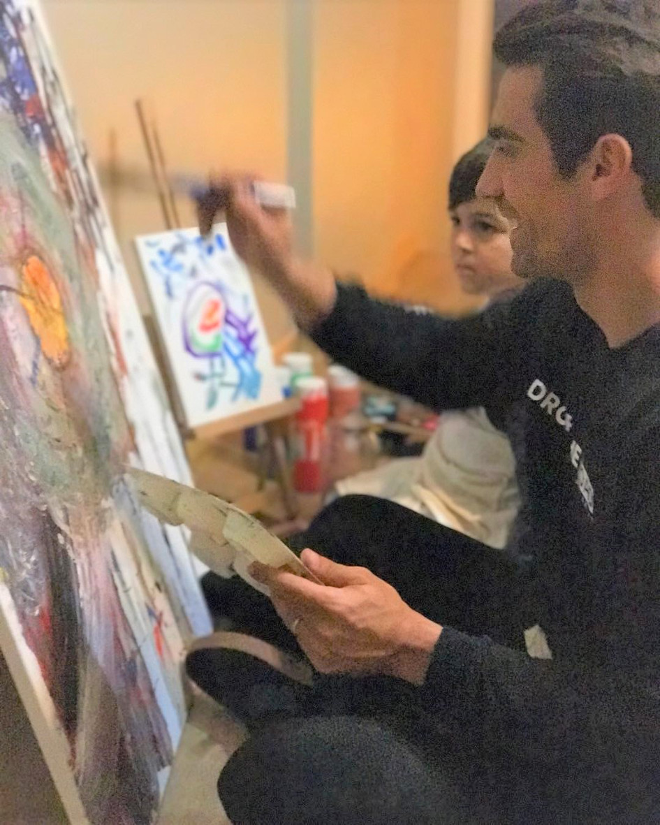 Ibrahim Celikkol with his nephew enjoying some art time together