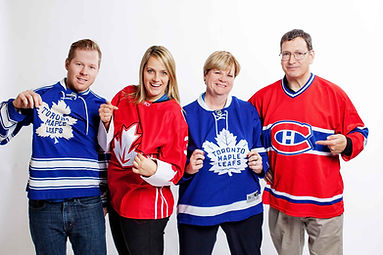 The De Repentigny family, jersey-clad, stand smiling. KnowledgeSurge Institute is a famil-run business that puts qualty first.