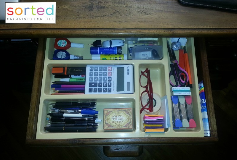 Cutlery organiser used in an office drawer