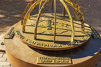 The mark of the geographical center of E
