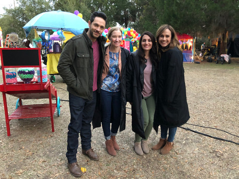 """Amanda Ayres with Nikki DeLoach, Michael Rady, and Stephanie Lusk on set of Hallmark's """"Love to the Rescue"""""""