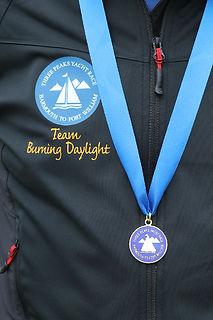 Wearing the race medal - three peaks yacht race