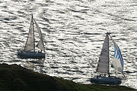 Close inshore at Bardsey Head in the Three Peaks Yacht Race