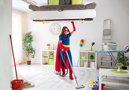 Strong super hero housewife cleaning hom