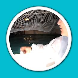 Jess Barron in feeding hatchery fish whi