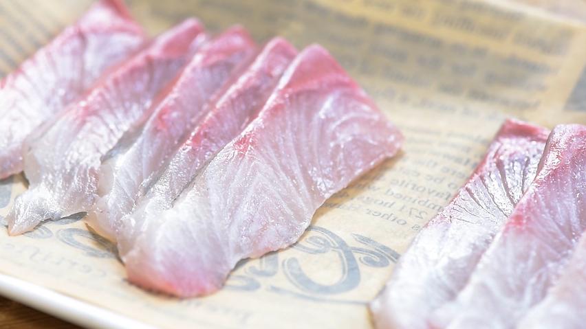 Thin slices of Omega Azul's Baja Kanpachi (also known as kampachi, amberjack, or longfin yellowtail)