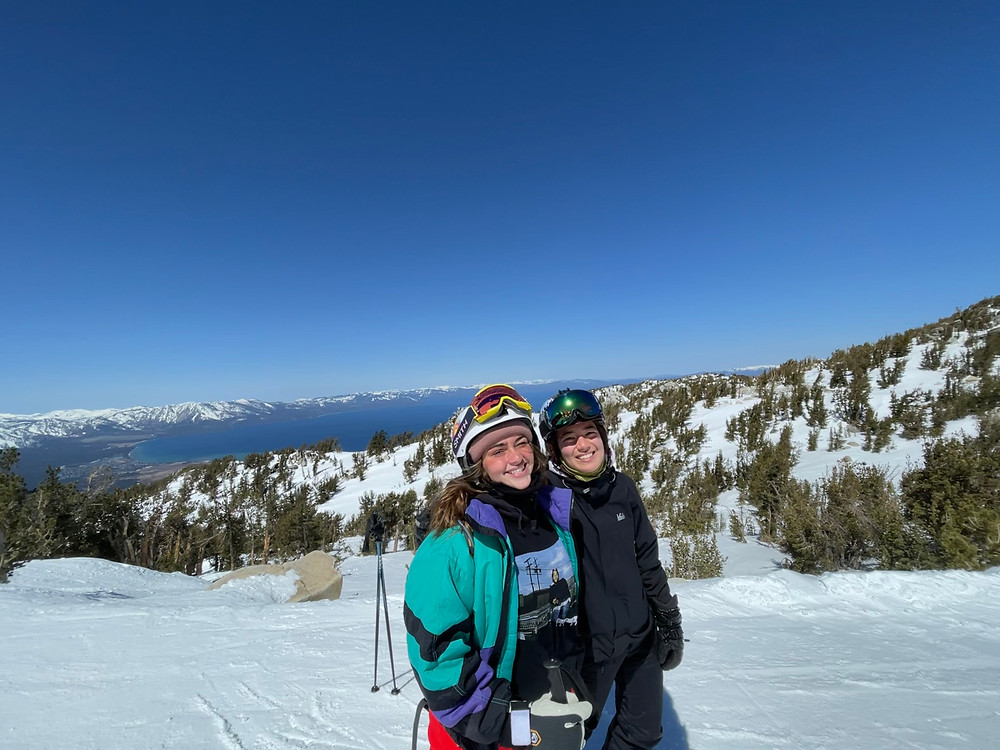 two girls on a ski slope