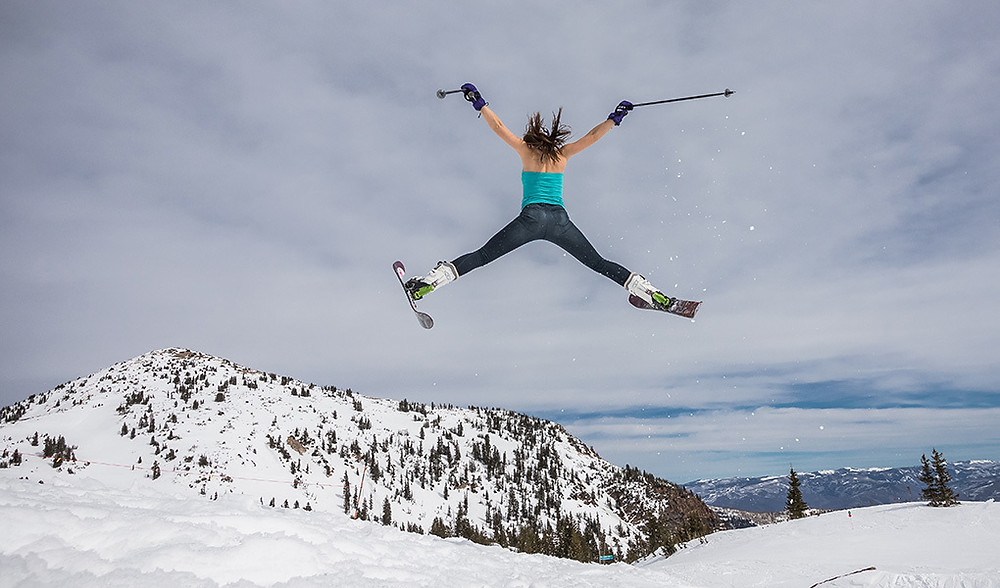 female skier jumping in the air