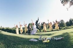 Bridal Party Jumping for Joy