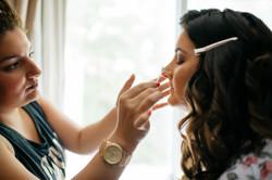 Meg getting her wedding day makeup