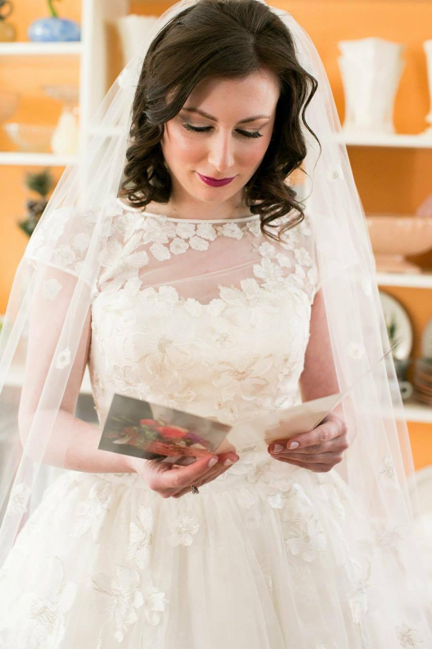 Katie reading her groom's letter