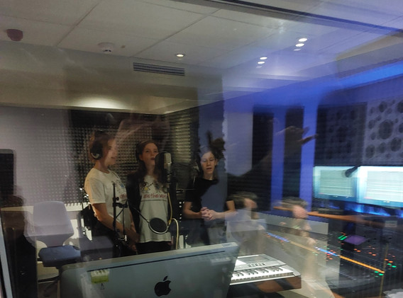 We Are the Voice recording at the studio