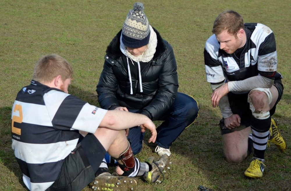 EW Sports Therapy treating a rugby player