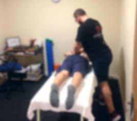 gav working on one of his clients dealing with a back issue