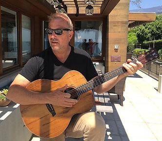 Kevin Costner with a Bent Twig Guitar