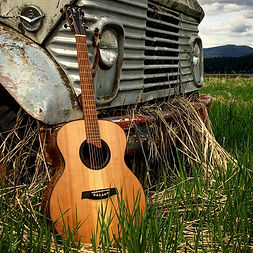 Bent Twig Guitar with an old truck