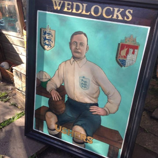 Graeme was commissioned to paint this by Bristol Sports. Wedlocks was a pub opposite Bristol City FC's ground, owned by Fatty Wedlock, until it was demolished. They kept the sign, and many years later asked Graeme to give it a new lease of life.