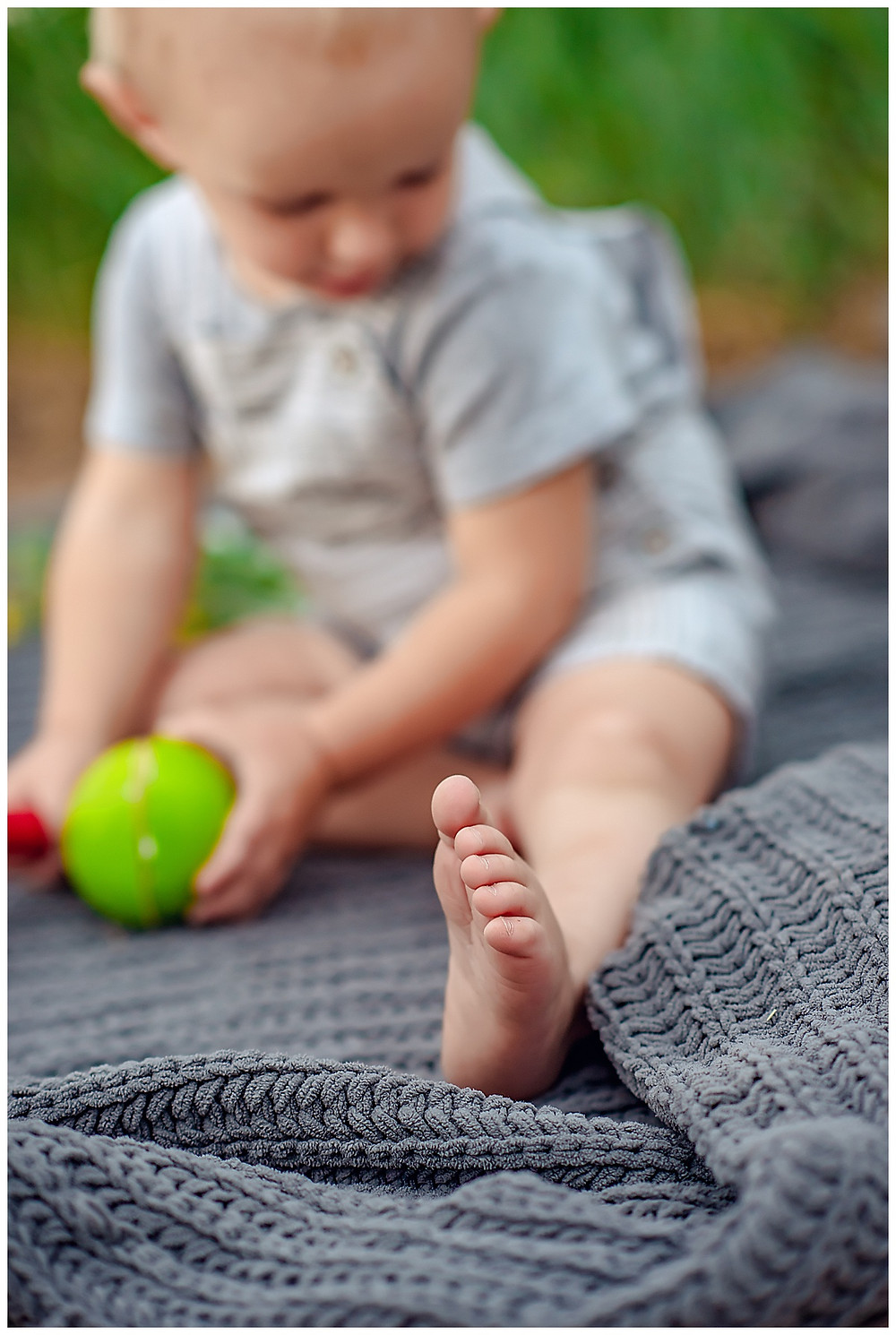 Toddler playing with tennis ball