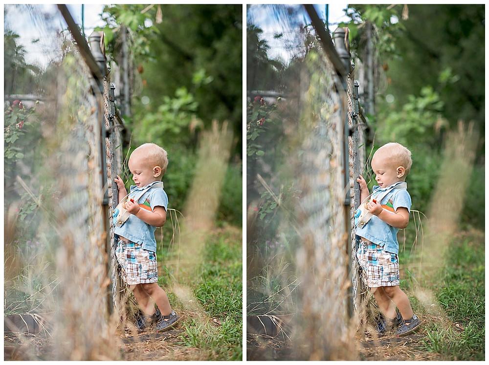 Toddler playing with fake camera
