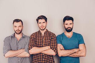 three handsome serious men cross hands w