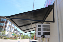 New powder coated standing seam awning on commercial building