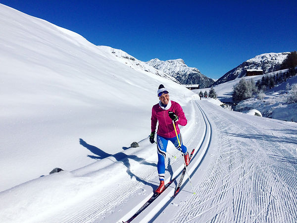 Martina skiing in Italy and now coaching Biathlon in Australia