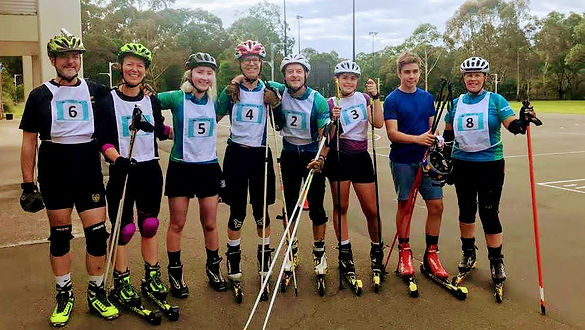The group with rollerskis on ready for laser Biathlon
