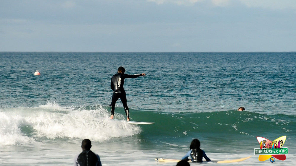 Marchall surfing his new longboard at Diaz Beach, Mossel Bay