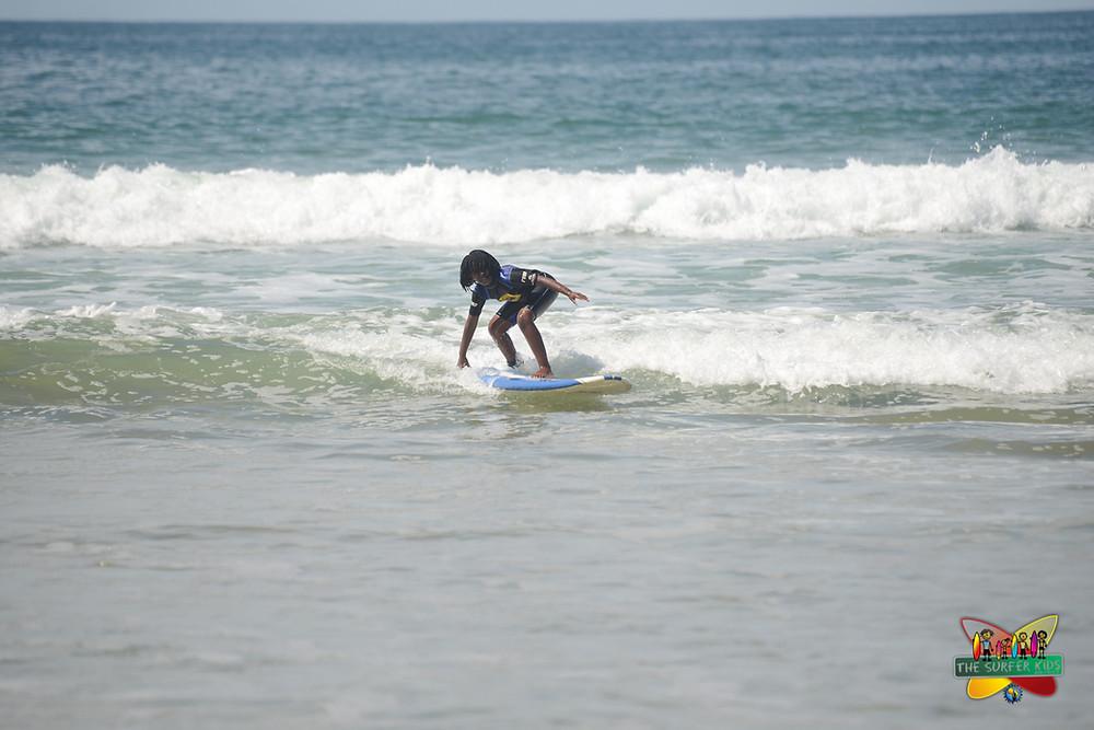 Zizi surfing at Diaz Beach, Mossel Bay, September 2015