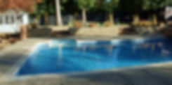 poolside landscape design with dry stone wall