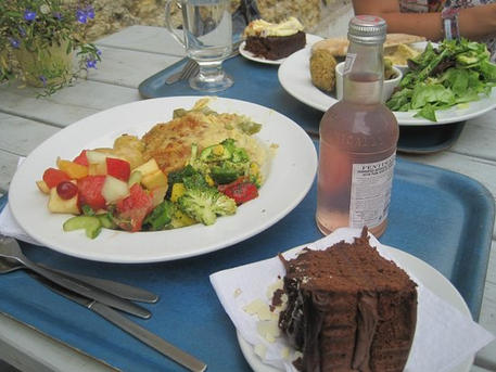 Salad and cake in the sunshine