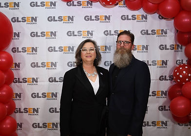 Two people in front of GLSEN Phoenix step-and-repeat including Tami Staas.