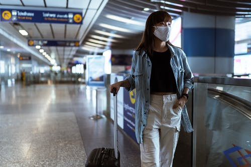 Masked Woman, Airport Concourse