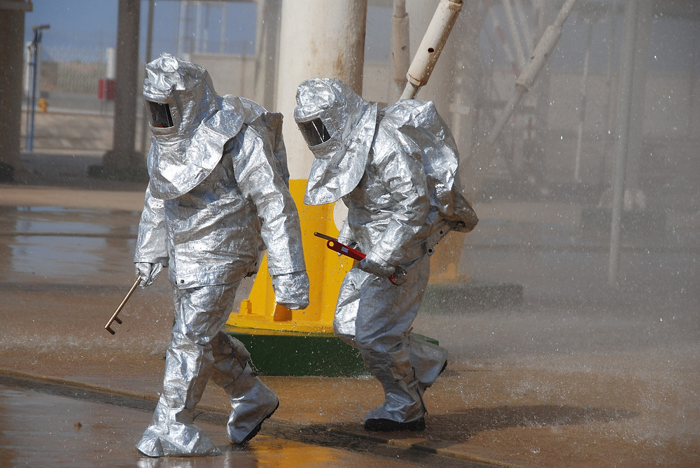 oil workers in fire suits