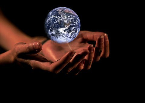 planet earth in the hands of a person