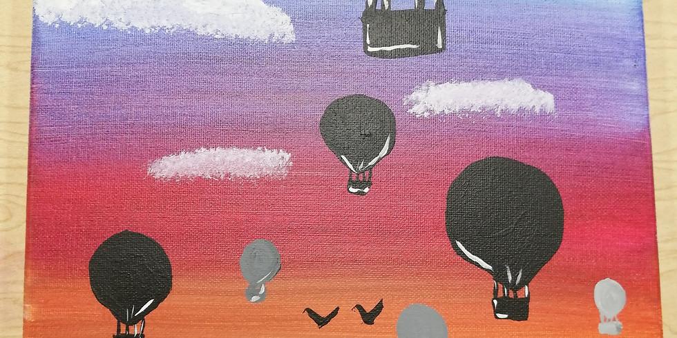 Rising Hot Air Balloons at Sunset