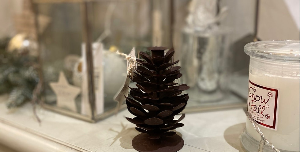 Fir cone candle holder