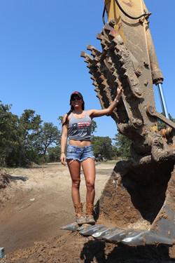 Girl standing next to equipment
