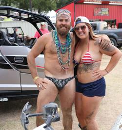 Shirtless man posing with girl