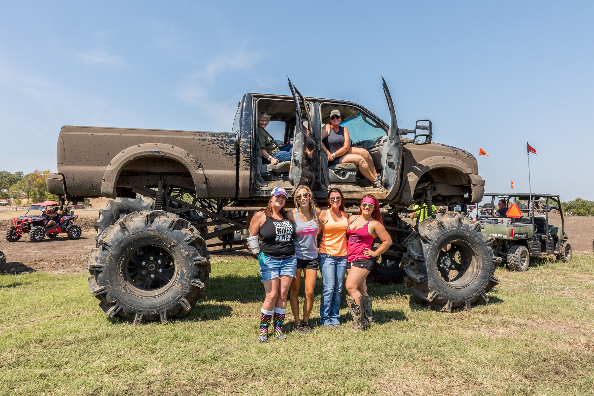 Family posing with Monster truck