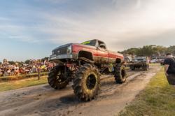 Monster truck driving on gravel road