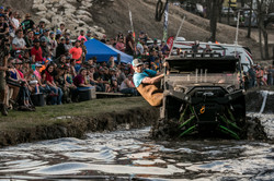 Man hangs out of vehicle in water